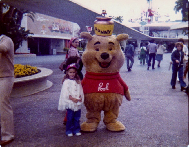 My sister with Winnie the Pooh in the Hunny Pot of the Future, aka Tomorrowland. CHeck out the amazing Mary Blair mural in the background!